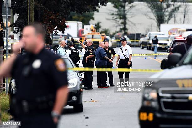 Law enforcement officers secure the area where they allegedly arrested terror suspect Ahmad Khan Rahami following a shootout in Linden New Jersey on...