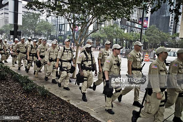 Law enforcement officers take their positions as activists demonstrate during a planned march on August 27 2012 in Tampa Florida The demonstration...