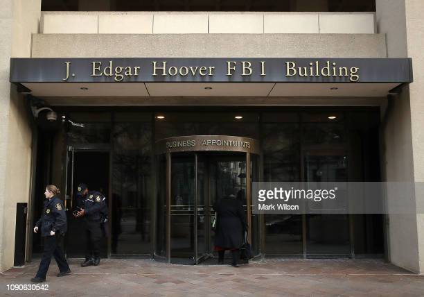Law enforcement officers walk out of the J. Edgar Hoover FBI Building on January 28, 2019 in Washington, DC. Last Friday President Donald Trump...