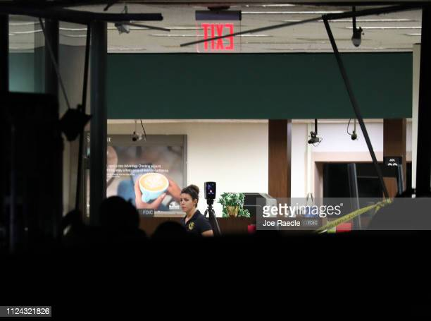 A law enforcement official investigates the scene where five people were killed at a SunTrust Bank branch on January 23 2019 in Sebring Florida The...
