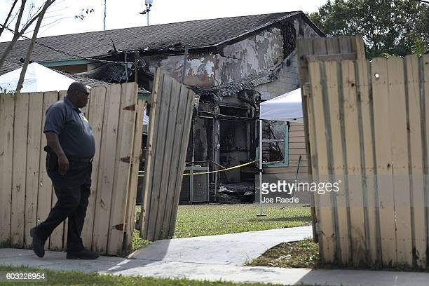 Law enforcement official walks near the scene of a fire at the Islamic Center of Fort Pierce which is the mosque that was attended by the Pulse...
