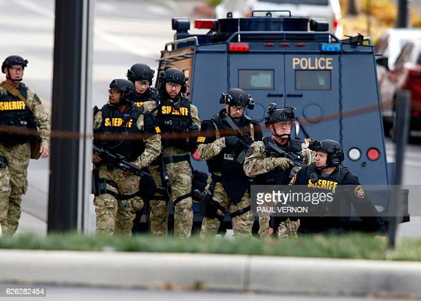 Law enforcement officials are seen outside of a parking garage on the campus of Ohio State University as they respond to an active attack in Columbus...