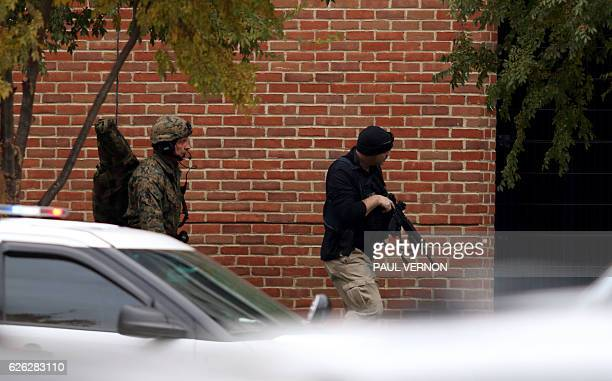 TOPSHOT Law enforcement officials are seen outside of a parking garage on the campus of Ohio State University as they respond to an active attack in...
