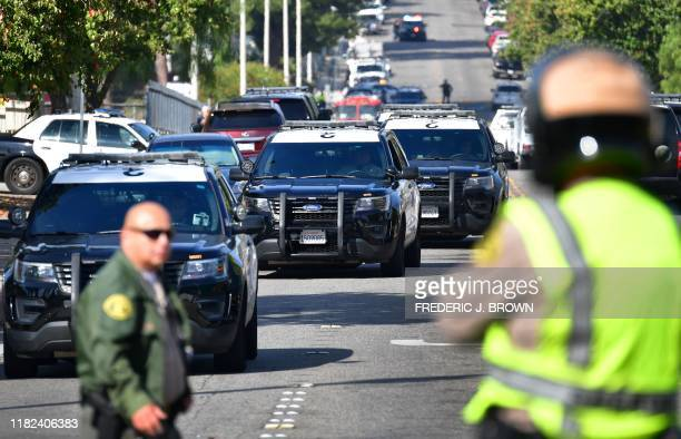 Law enforcement officials are seen outside Saugus High School at Central Park in Santa Clarita California on November 14 2019 A teenage boy gunned...