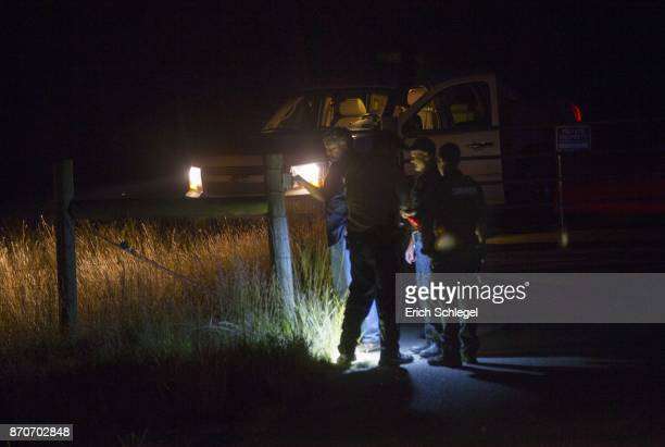 Law enforcement officials at the front gate to the home and property of Devin P Kelley on November 5 2017 near New Braunfels Texas According to...