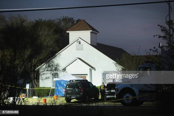Law enforcement officials continue their investigation at First Baptist Church of Sutherland Springs as the sun begins to rise on November 6 2017 in...