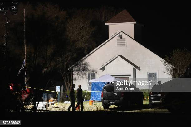 Law enforcement officials continue their investigation at First Baptist Church of Sutherland Springs during the early morning hours of November 6...