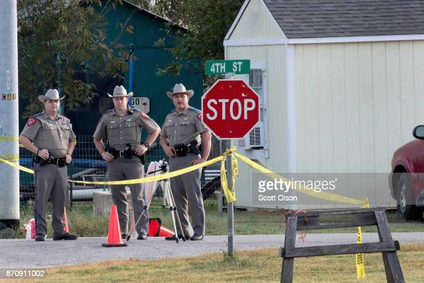 Law enforcement officials continue their investigation at the First Baptist Church of Sutherland Springs on November 6 2017 in Sutherland Springs...