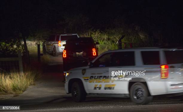 Law enforcement officials enter the property of Devin P Kelley on November 5 2017 near New Braunfels Texas According to reports Kelley entered a...