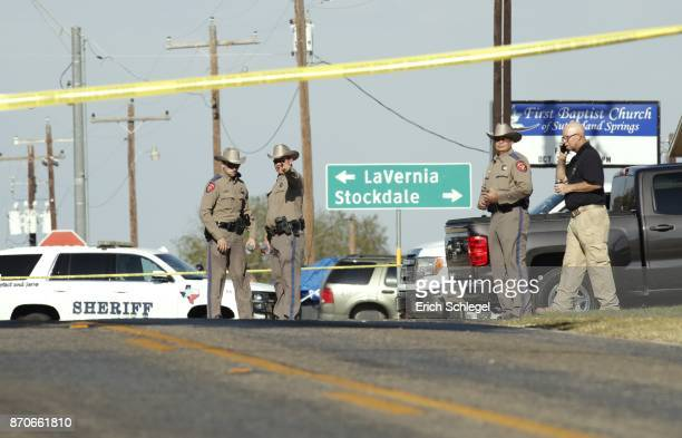 Law enforcement officials gather near First Baptist Church following a shooting on November 5 2017 in Sutherland Springs Texas At least 26 people...
