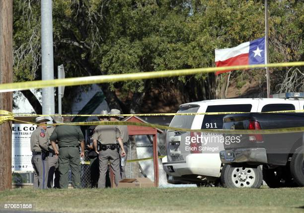 Law enforcement officials gather near the First Baptist Church following a shooting on November 5 2017 in Sutherland Springs Texas At least 20 people...