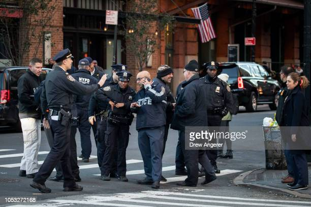 Law enforcement officials gather near the scene of where another package bomb was found early Thursday morning at Robert De Niro's Tribeca Grill...