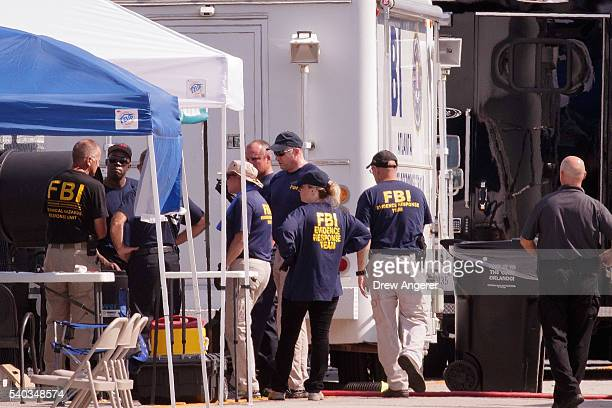 Law enforcement officials including members of the Federal Bureau of Investigation work near the crime scene at Pulse Nightclub on Orange Avenue June...