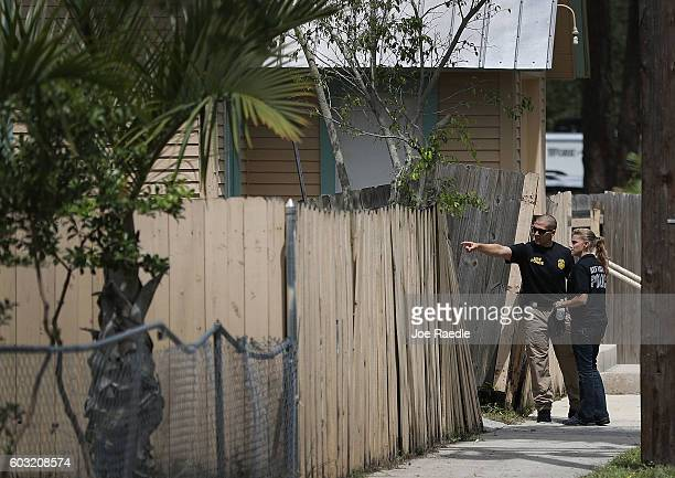 Law enforcement officials investigate a fire at the Islamic Center of Fort Pierce which was the mosque attended by the Pulse nightclub gunman who...