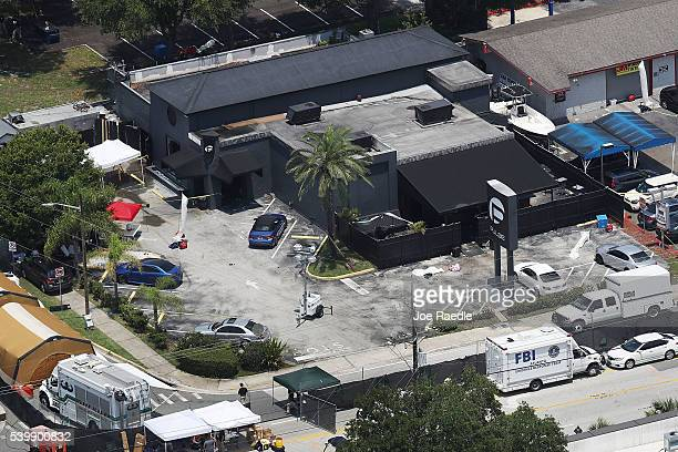 Law enforcement officials investigate at the Pulse gay nightclub where Omar Mateen allegedly killed at least 50 people on June 13, 2016 in Orlando,...