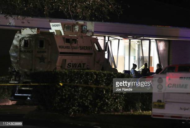 Law enforcement officials investigate the scene where five people were killed at a SunTrust Bank branch on January 23 2019 in Sebring Florida The...