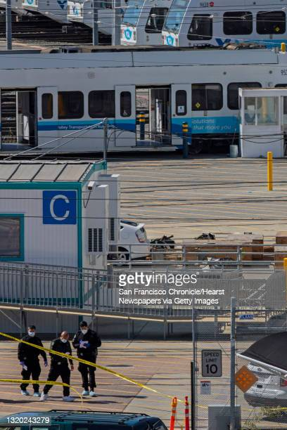Law enforcement officials investigate the VTA Light Rail Facility yard, Wednesday, May 26 in San Jose, Calif. A shooting at the light-rail yard near...