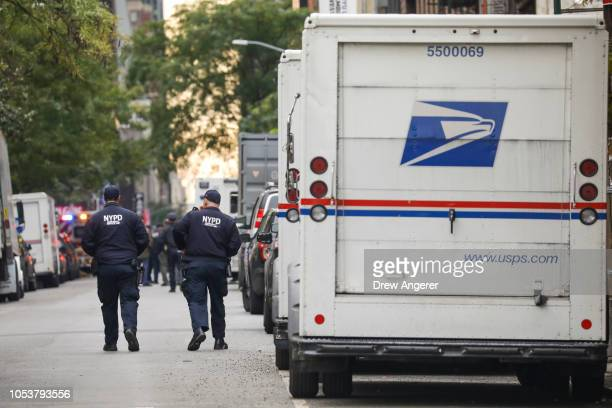 Law enforcement officials respond to a suspicious package at a US Post Office facility at 52nd Street and 8th Avenue in Manhattan October 26 2018 in...