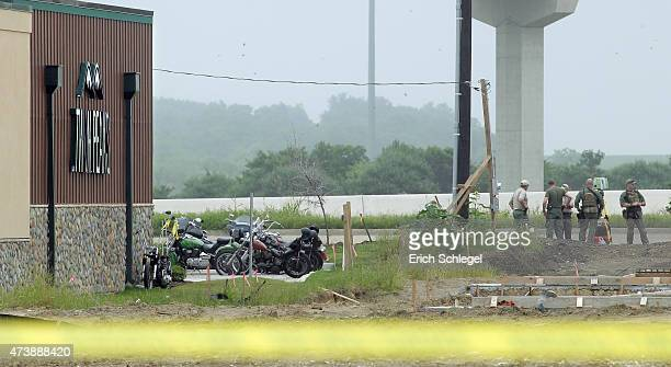 Law enforcement officials stand at the scene of a motorcyle gang shootout theTwin Peaks restaurant May 18 2015 in Waco Texas A shootout between rival...