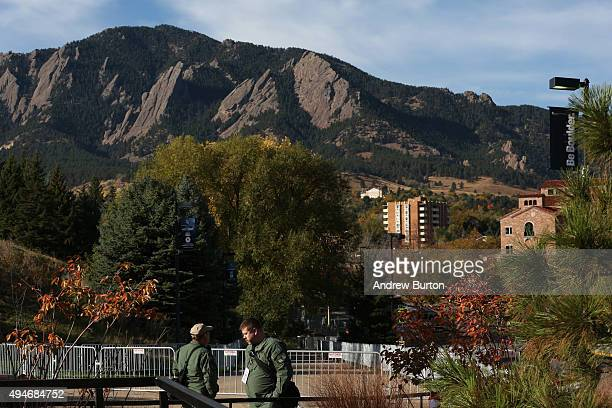 Law enforcement officials stand guard outside the CNBC Republican presidential debate at the University of Colorado prior to the event on October 28...