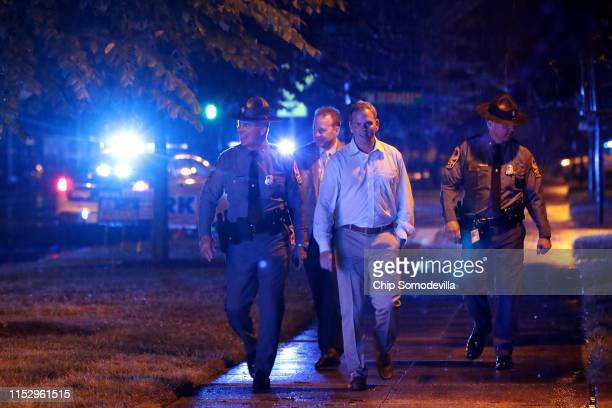 Law enforcement officials walk the perimeter of the Municipal Center following a deadly mass shooting May 31 2019 in Virginia Beach Virginia At least...