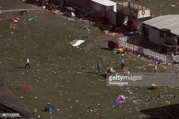 Law enforcement officials work the scene of the mass shooting at the Route 91 Harvest Festival October 3 2017 in Las Vegas Nevada The gunman...
