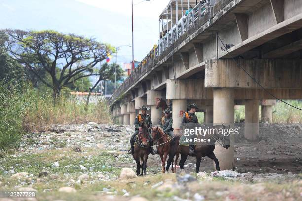 Law enforcement personnel are seen next to the Colombian side of the Simón Bolívar international bridge which connects Cúcuta with the Venezuelan...