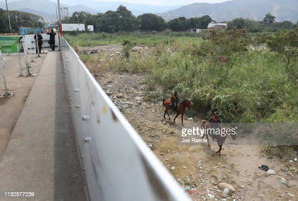 Law enforcement personnel are seen on the Colombian side of the Simón Bolívar international bridge which connects Cúcuta with the Venezuelan town of...
