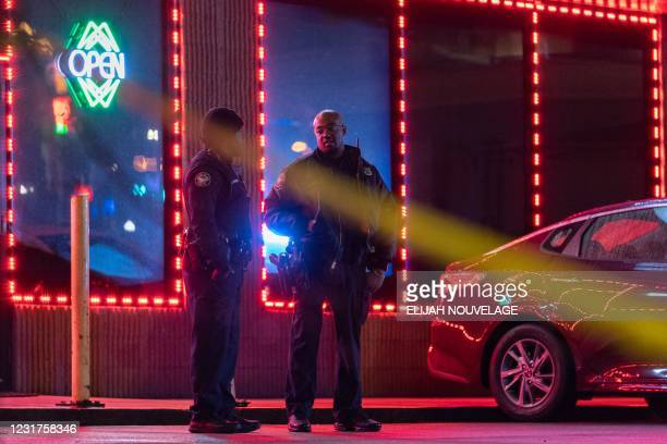 Law enforcement personnel are seen outside a massage parlor where a person was shot and killed on March 16 in Atlanta, Georgia. - Eight people were...