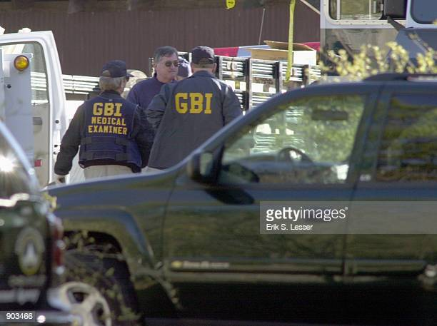 Law enforcement personnel confer outside the TriState Crematory February 16 2002 in the north Georgia town of Noble State investigators have...