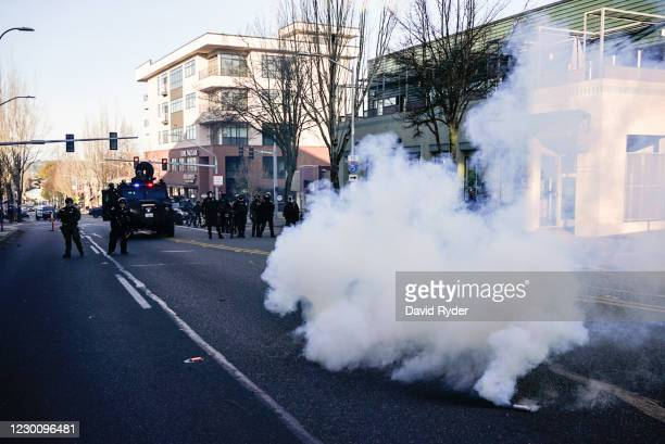Law enforcement personnel disperse anti-fascist protesters during political clashes on December 12, 2020 in Olympia, Washington. Far-right and...