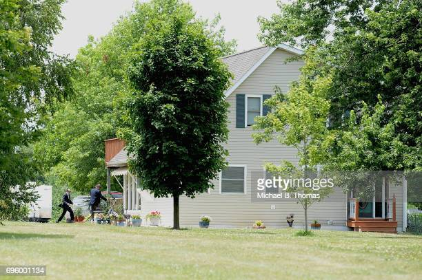 Law Enforcement personnel enter the home of James Hodgkinson during their investigation in Belleville Illinois on June 14 2017 Hodgkinson was...