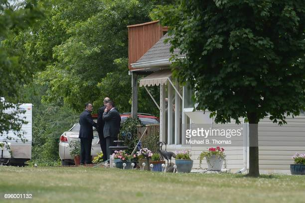 Law Enforcement personnel huddle outside the home of James Hodgkinson in Belleville Illinois on June 14 2017 Hodgkinson was identified as shooter in...