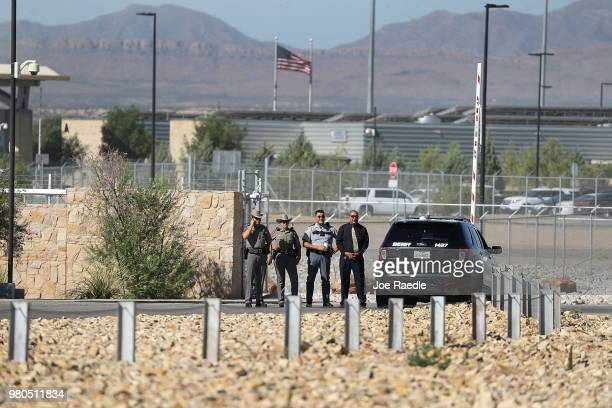 Law enforcement personnel keep an eye on the mayors and media at the TornilloGuadalupeÊPort of EntryÊon June 21 2018 in Fabens Texas Mayors from the...
