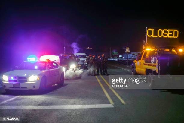 Law enforcement personnel monitor an intersection of closed Highway 395 in Burns Oregon on January 26 during a standoff pitting an antigovernment...