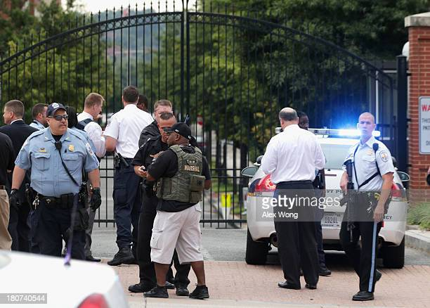 Law enforcement personnel respond to a reported shooting at an entrance to the Washington Navy Yard September 16 2013 in Washington DC According to...