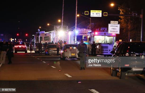 Law enforcement personnel work the scene at the Marjory Stoneman Douglas High School after a shooting at the school that killed 17 people on February...