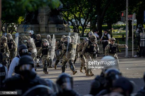 Law enforcement responds during a protest near Lafayette Park ahead of President Trump's trip to St. John's Church on June 1, 2020 in downtown...