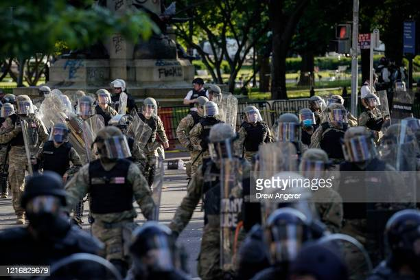 Law enforcement responds during a protest near Lafayette Park ahead of President Trump's trip to St John's Church on June 1 2020 in downtown...