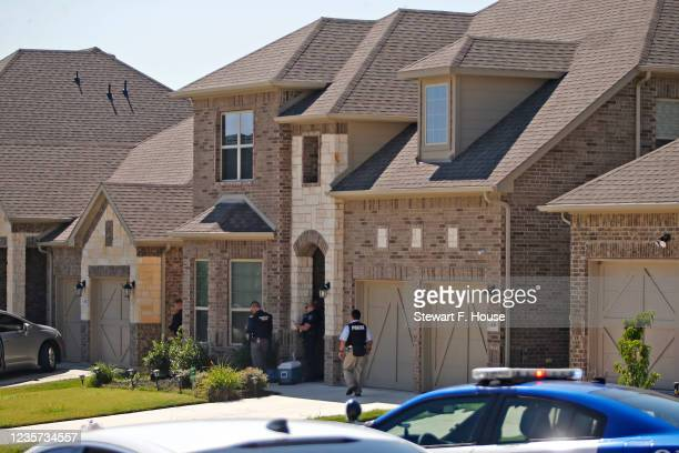 Law enforcement search a home while looking for the suspect in a shooting at Timeberview High School on October 6, 2021 in Arlington, Texas....
