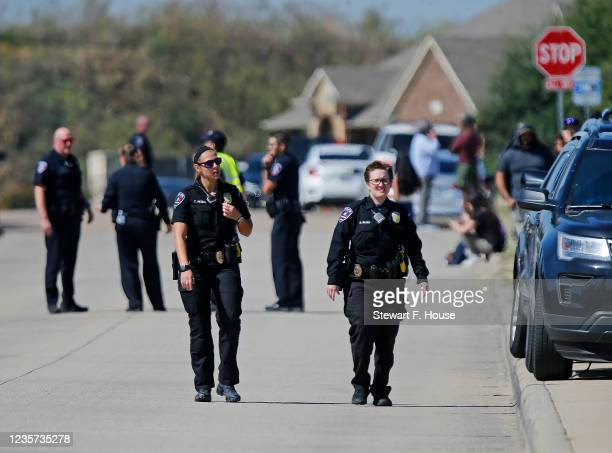 Law enforcement secure streets leading into Timberview High Shcool after they responded to a student shooter on campus on October 6, 2021 in...