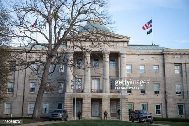 Law enforcement stand guard outside of the state capitol building in downtown Raleigh, North Carolina, on January 17 during a nationwide protest...