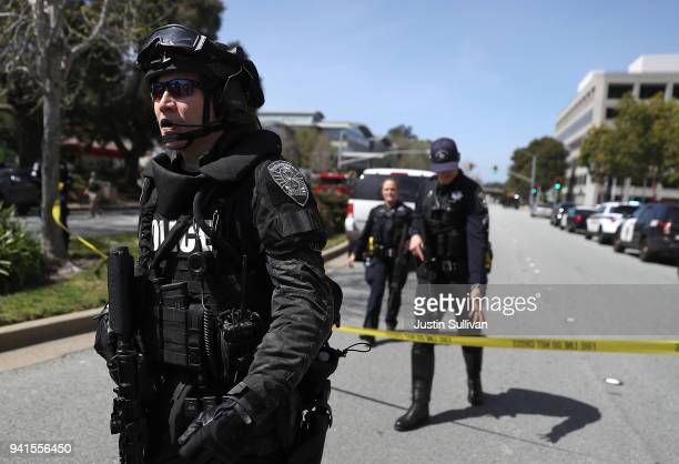 Law enforcement stands watch outside of the YouTube headquarters on April 3 2018 in San Bruno California Police are investigating an active shooter...