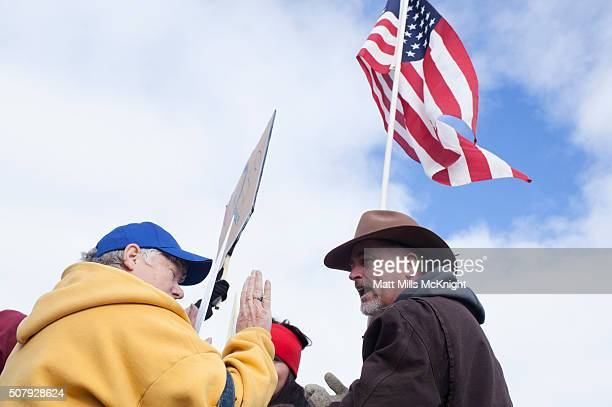 Law enforcement supporters and antigovernment protesters argue outside the Harney County Courthouse on February 1 2016 in Burns Oregon Approximately...