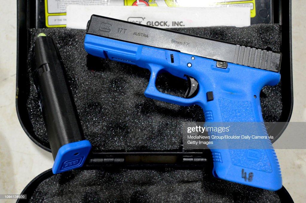 A law enforcement training pistol that fires a simunition