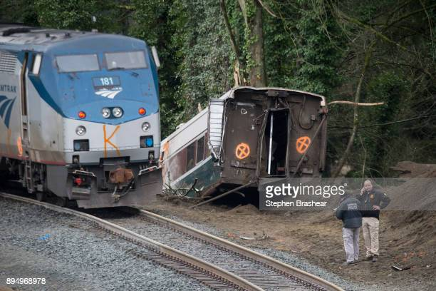 Law enforcement work at the scene of a Amtrak train derailment on December 18 2017 in DuPont Washington At least six people were killed when a...