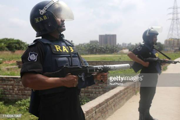 Law enforcers cordon off arround a suspected militant hideout at Bosila in Dhaka Bangladesh on April 29 2019 At least one people is killed in...