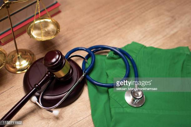 law firm: medical malpractice - medical malpractice stock photos and pictures