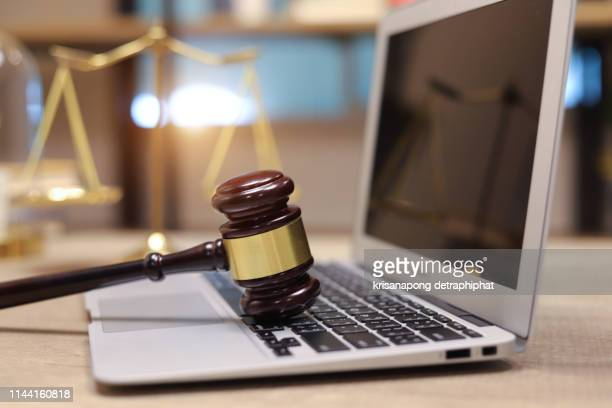 law legal technology concept. judge gavel and computer on desk of lawyer with legal icon - judge law stock pictures, royalty-free photos & images