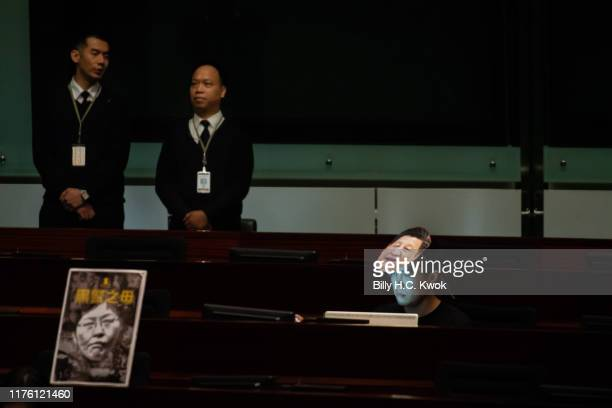 A law maker wears a Chinese president Xi Jingping's mask during Hong Kong's Chief Executive Carrie Lam give her annual policy address at the...
